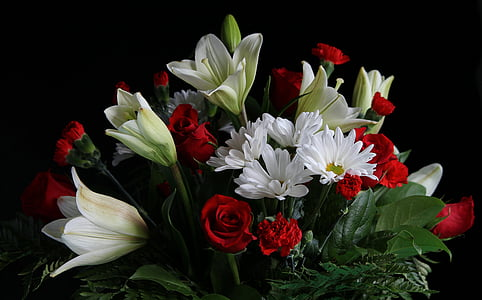 white lilies, chrysanthemum, and red roses arrangement