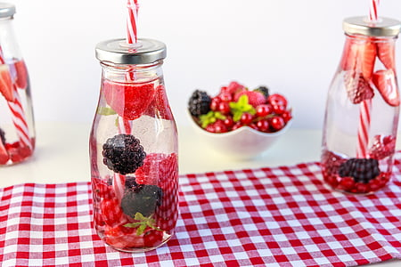 berry filled glass bottle