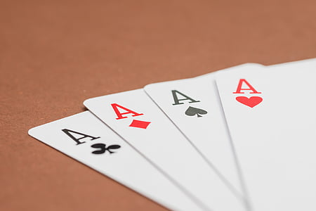 four a playing cards on surface