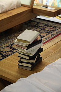 photo of piled books on table