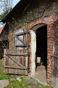 opened door red concrete wall brick house