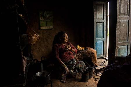 woman sitting looking on door