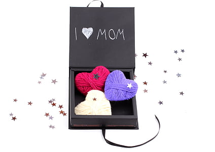 three heart yarns in black wooden box