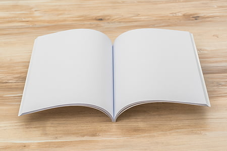 book page on beige wooden surface