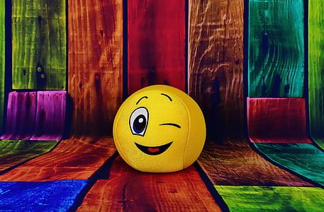yellow emoji on multicolored wood parquet graphic wallpaper