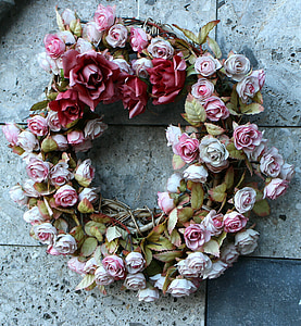 pink and red rose wreath on floor