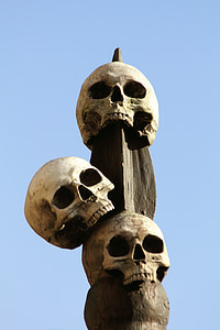 three skull on wooden finial