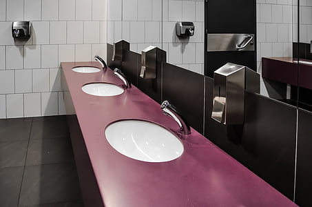 purple bathroom sink with mirror