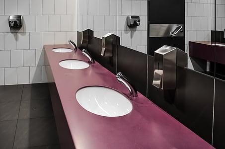 purple bathroom sink with mirror