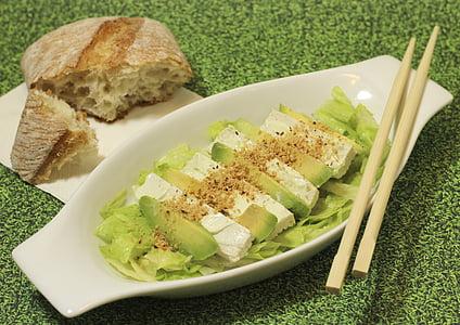 sliced fruit with vegetable leaf and chopsticks on bowl