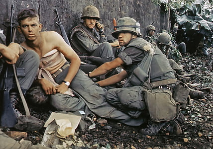 soldiers sitting on ground leaning on wall