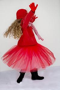 girl wearing red coat and tutu skirt