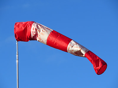 red and white air tube flag with pole