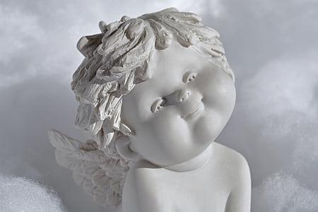 shallow focus photography of angel figurine