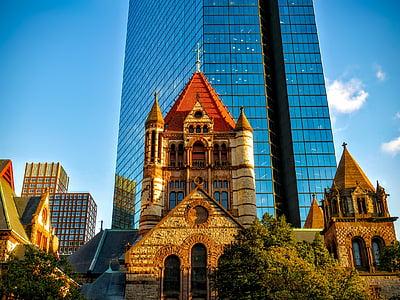 blue glass building near church