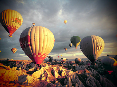 flying hot air balloons during daytime