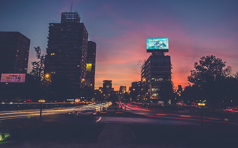 timelapse photography of street with skyscrapers