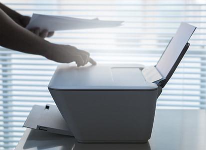 person using white desktop printer