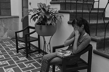 girl sitting on armchair