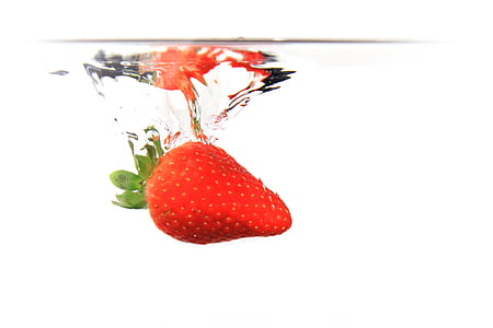 strawberry drop in clear fluid