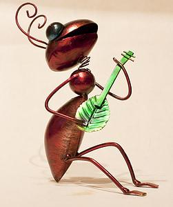 ant playing leaf guitar figurine