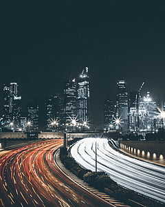 timelapse photography of city buildings and road
