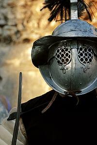 gray metal gladiator helmet