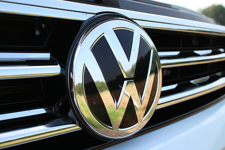 closeup photography of silver-colored Volkswagen vehicle emblem