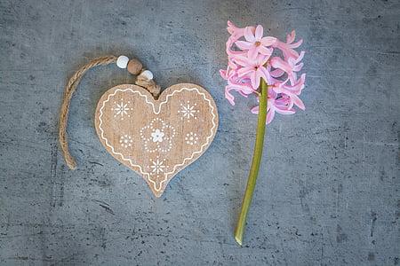 brown heart wooden decor near pink flower