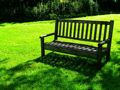 gray wooden bench on grass field