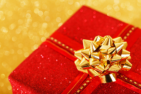 red gift box with gold-colored ribbon