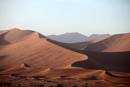 brown desert mountains at daytime