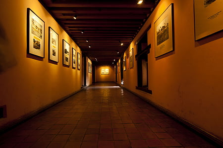 well-lit hallway with photo framed photos
