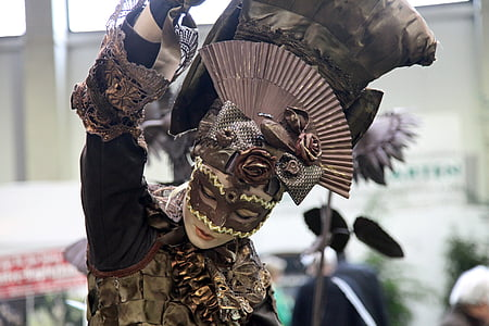 woman performing dance in mask costume