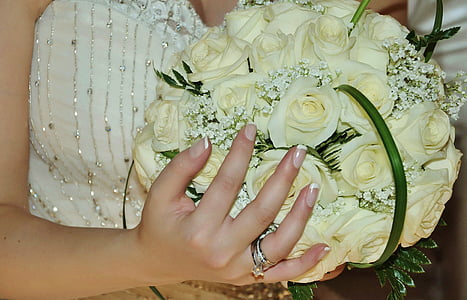 woman holding white rose flower bouquet
