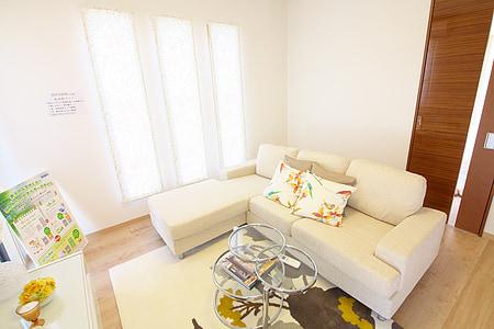 white fabric divan sofa beside the window