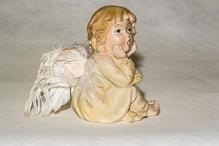 angel put her hand on chin figurine