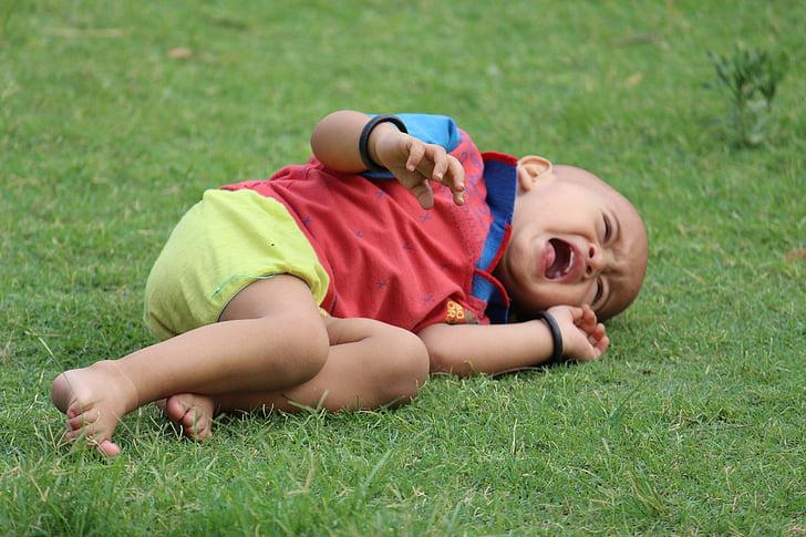 baby lying on grass