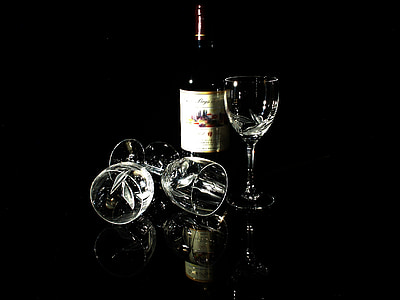 wine bottle with three clear wine glasses