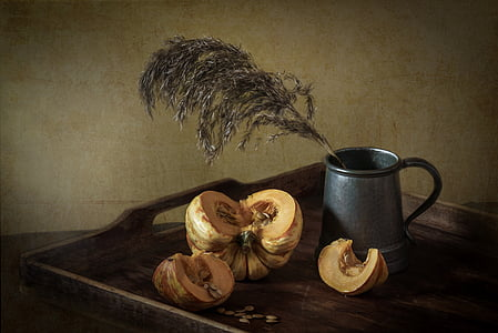 gray stainless steel cup beside squash vegetable still-life painting
