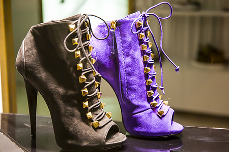 two unpaired purple and brown suede peep-toe stiletto booties