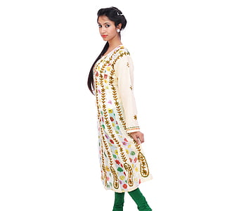woman wearing white and green tunic dress and pants