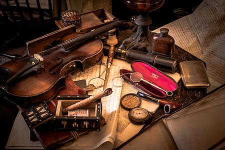 brown violin beside cases
