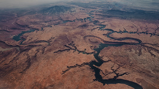 aerial photography of body of water near mountain