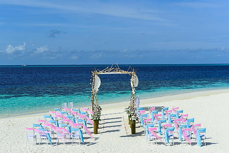 pink and blue beach wedding setup