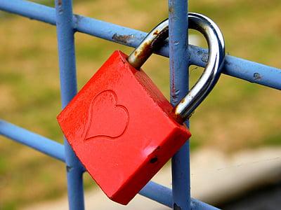 closeup photo of red and gray padlock
