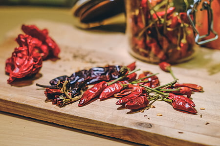 red chili on brown wooden chopping board