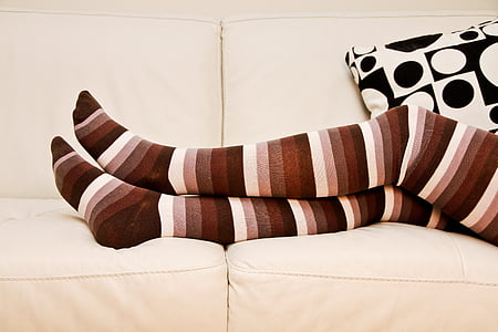 person wearing brown-black-and-white striped knee high socks