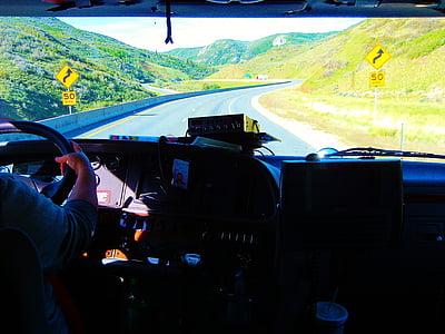 person driving a car simulator