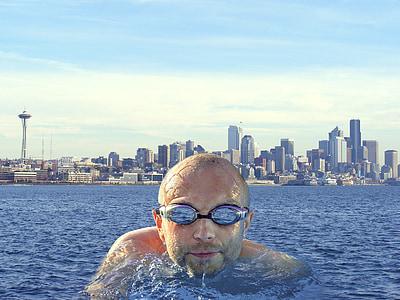 man on body of water facing camera